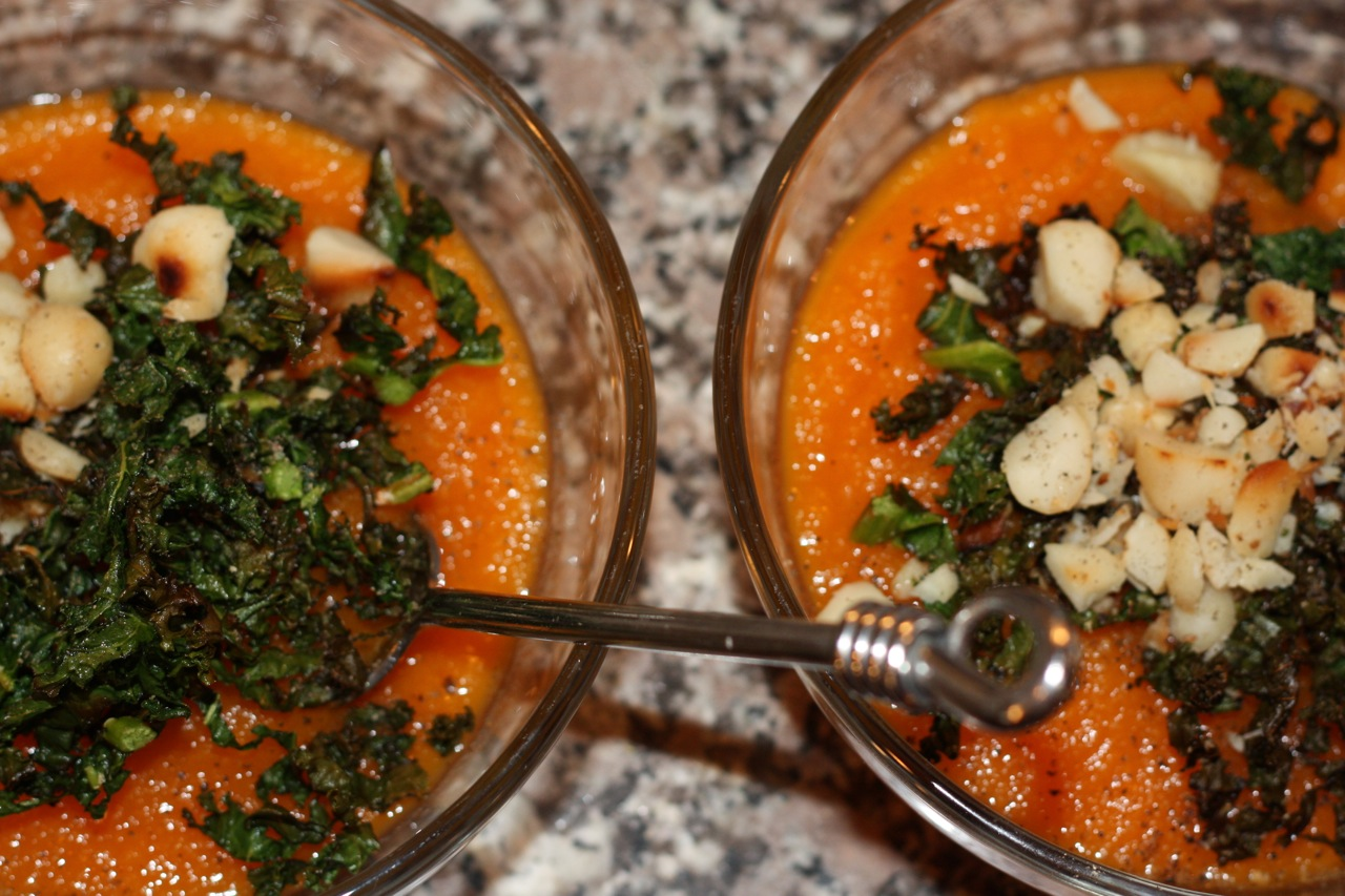 Carrot Ginger Soup with Kale Shreds and Toasted Macadamias